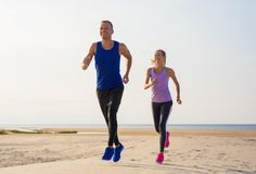 Man and woman exercise outdoors royalty free stock photos