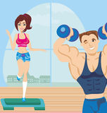 Man and woman exercises in the gym Royalty Free Stock Photos