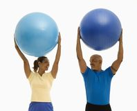 Man and woman exercising. Royalty Free Stock Photos