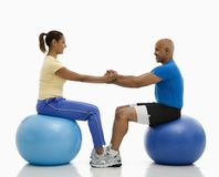 Man and woman exercising. Royalty Free Stock Images