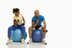 Man and woman exercising. Royalty Free Stock Photo