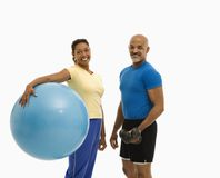Man and woman exercising. Stock Image