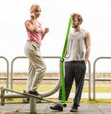 Man and woman exercising on elliptical trainer. Stock Photography