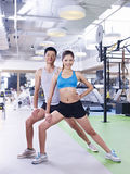 Man and woman exercising in gym Royalty Free Stock Image
