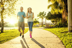 Man and woman exercising and jogging together at the park Royalty Free Stock Images