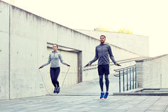 Man and woman exercising with jump-rope outdoors Stock Photos