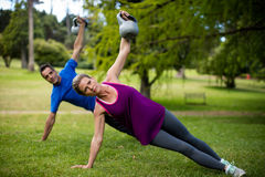 Man and woman exercising with kettlebell Royalty Free Stock Image