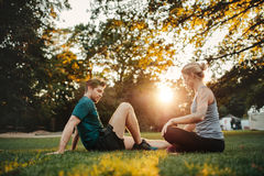 Man and woman exercising at park in morning Stock Images
