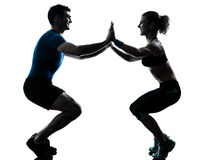 Man woman exercising squatts workout fitness Stock Photo