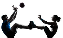 Man woman exercising workout tossing fitness ball Royalty Free Stock Image