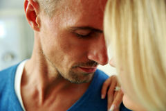Man and a woman face to face with eyes closed. Closeup portrait of a men and a women face to face with eyes closed stock image