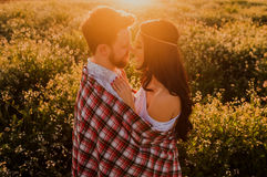 Man and Woman Face to Face Near Yellow Flowers during Daytime Royalty Free Stock Photography