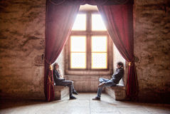 Man and Woman Facing Each Other Beside the Window Stock Photography