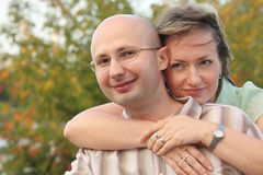 Man and woman in fall park. woman is embracing man Royalty Free Stock Photos