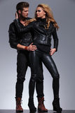Man and woman in fashionable leather clothes looking at each Royalty Free Stock Images