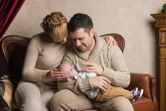 A man and a woman are feeding the baby from the bottle royalty free stock photography