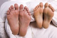 Man and woman feet Stock Image