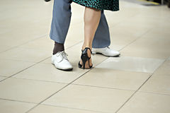 Man and woman feet dancing tango argentino. Man and woman feet dancing tango Royalty Free Stock Photo