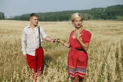 A man and a woman in a field Royalty Free Stock Photos