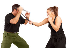 Man and woman fight using knife and truncheon. Man and woman practce fight using knife and truncheon royalty free stock photos
