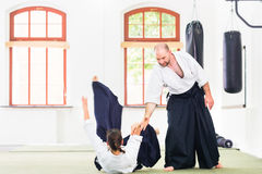 Man and woman fighting at Aikido martial arts school Royalty Free Stock Photos