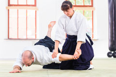 Man and woman fighting at Aikido martial arts school Stock Images