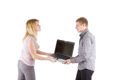 Man and woman fighting over laptop Stock Photo
