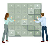 Man and woman in filing cabinet Royalty Free Stock Images