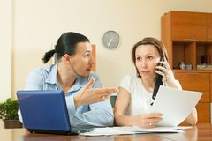 Man and woman with financial document at home Stock Photography