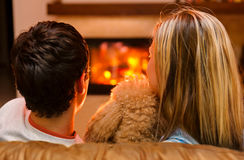 The man with the woman at the fireplace Royalty Free Stock Photography
