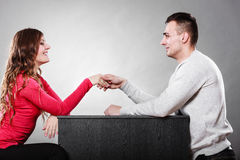 Man and woman first date. Handshake greeting. Man and women first date meeting. Handshake greeting. Male and female shaking hands and getting to know each other Stock Images