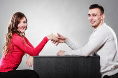 Man and woman first date. Handshake greeting. Stock Photo