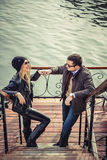 Man and woman fist bumping. Man and women fist bumping by the river Royalty Free Stock Image