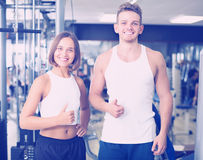 Man and woman fitness coaches in gy Royalty Free Stock Photography