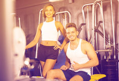 Man and woman fitness coaches in gym Royalty Free Stock Photo