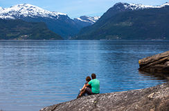 Man and woman on a fjord coast Stock Image