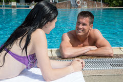 Man and woman flirting at swimming pool Royalty Free Stock Photo