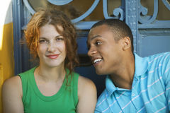 Man and woman flirting. Young happy men and women flirting Royalty Free Stock Images