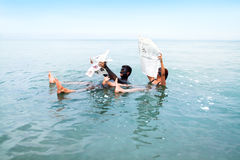 Man and woman floating at the Dead Sea Stock Photos