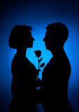 Man and woman and flower Stock Images