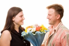 Man, woman and flowers Stock Images