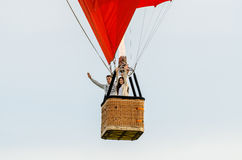 Man and woman flying in the air balloon Stock Images