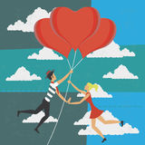 Man and woman flying with balloons of love Stock Photo