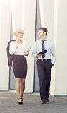 Man and woman in formalwear in the street. Stock Photography