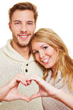 Man and woman forming heart Stock Images