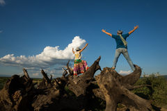 Man and woman in freedom blue sky. Man and women express freedom at blue sky view stock image