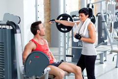 Man and woman friends on sport gym relaxed Royalty Free Stock Image