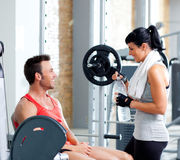 Man and woman friends on sport gym relaxed. Man and women friends on sport fitness gym relaxed Royalty Free Stock Photos