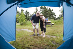A man and woman in front of their camping tent Stock Photography