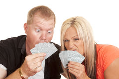 Man and woman funny expression behind playing cards Royalty Free Stock Images